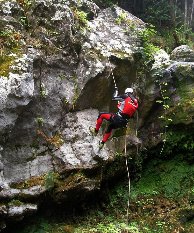 Canyoning Madeira abseiling large rock